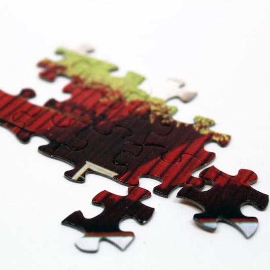 Showcase your artwork with a custom puzzle. Check out our jigsaw puzzle options and then contact us to get a custom quote.